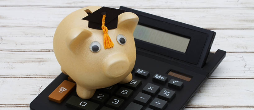 calculator with a piggy bank and graduation cap