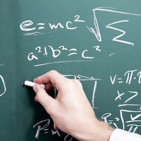 Maths equations on a black board