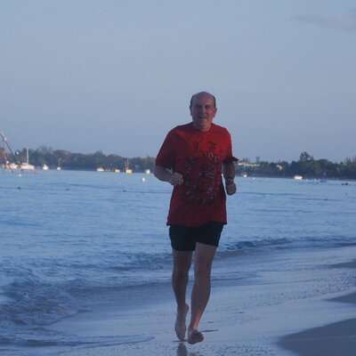 Student jogging on beach