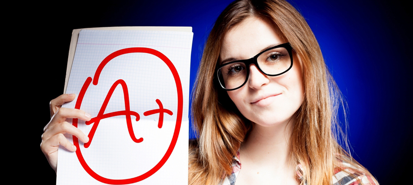 Female student holing up large A+ grade