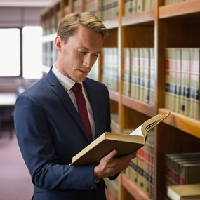 Law student reading case notes in library